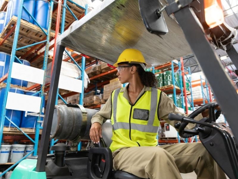 female staff driving forklift